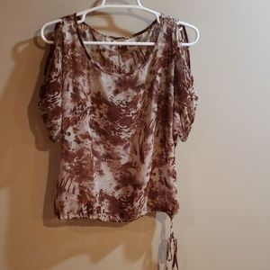 Sheer top with should cut outs.
